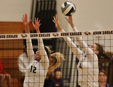 Avon's Sydney Stone (4) and Sarah Sprecher (12) go up for the block in Tuesday night's game vs Avon Lake. AMANDA K. RUNDLE/CHRONICLE