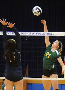 Amherst 21 Mallory Sliman hits over Lorain Serena Rodriguez in sectional Oct. 17.  Steve Manheim
