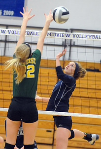 Lorain Onyx Lopez hits above Amherst Alyssa  Standen in sectional Oct. 17.  Steve Manheim