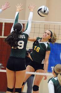Amherst's Ashley Makruski hits past Strongsville's Hannah Mott. STEVE MANHEIM/CHRONICLE