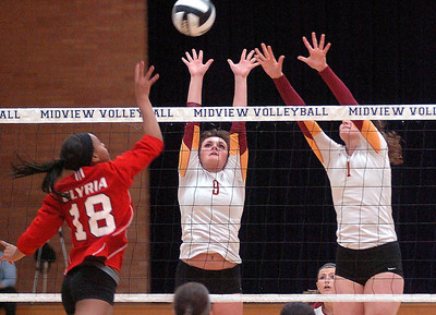 Elyria's Danya Corlew, left, tries to spike the ball past Avon Lake's Alaina Silwinsi, center, and Katie Coughlin. LINDA MURPHY/CHRONICLE