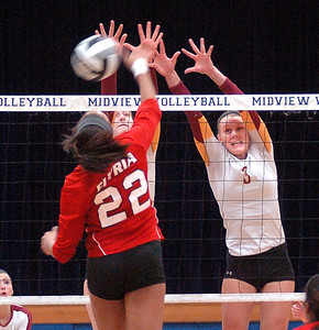 Elyria's Alexis Middlebrooks tries to spike the ball past Avon Lake's Katie Coughlin and Lauren Bakaitis, right. LINDA MURPHY/CHRONICLE