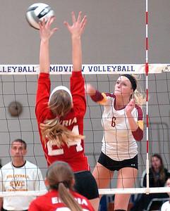 Avon Lake's Katie Mihalik spikes a ball past Elyria's Abigail Elek. LINDA MURPHY/CHRONICLE