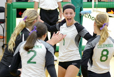 Columbia celebrates after scoring a point against Firelands. KRISTIN BAUER | CHRONICLE