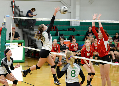 Columbia's Rebecca Tacchite spikes the ball over the net as Firelands' Dalaney Rogala blocks.  KRISTIN BAUER | CHRONICLE