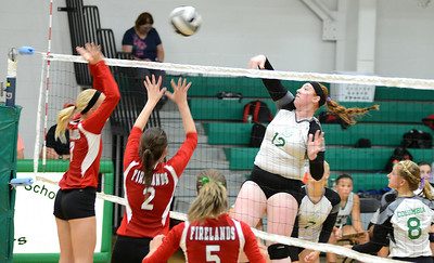 Columbia's Shelby Friedel spikes the ball over the net past Firelands' Keely Hall and Dalaney Rogala. KRISTIN BAUER | CHRONICLE