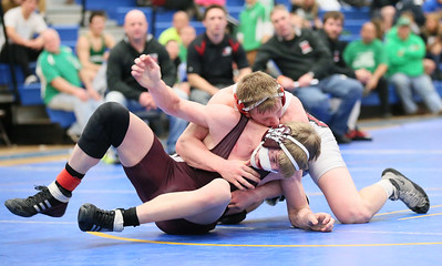 Wellington's Imhoff had a hard fought and bloody match for 2nd in 160 lb class in the Div III sectional tournament at Independence High School. photo by Ray Riedel