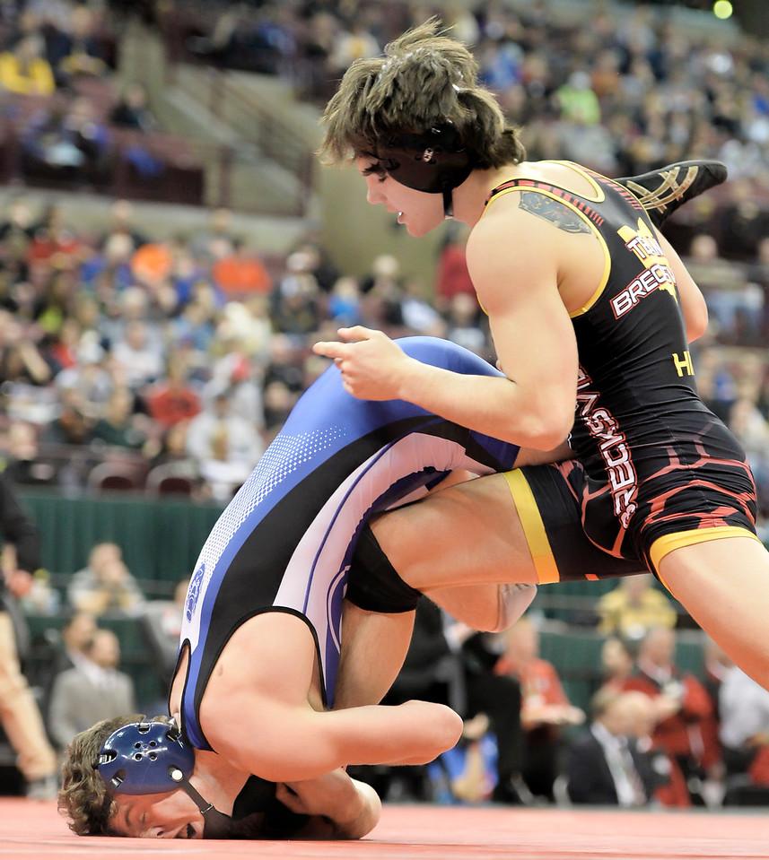 Nick Kiussis, right, of Brunswick grabs the leg of Brecksville's Austin Hiles during the 152-pound state championship match. DAVID RICHARD / GAZETTE