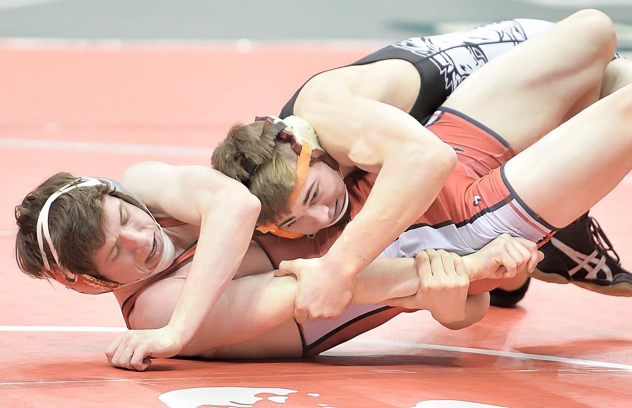 Greg Briggs, right, of Cloverleaf, grabs the arm of Johnstown-Monroe's Hayden Bullard in a 138-pound, second round consolation match. DAVID RICHARD / GAZETTE