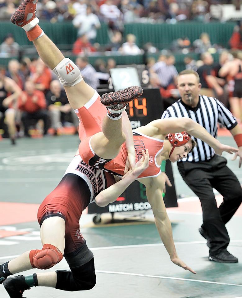 Joey Baughman of Wadsworth is taken down by Dylan Roth of Cincinnati Oak Hills in a 160-pound semifinal match. DAVID RICHARD / GAZETTE