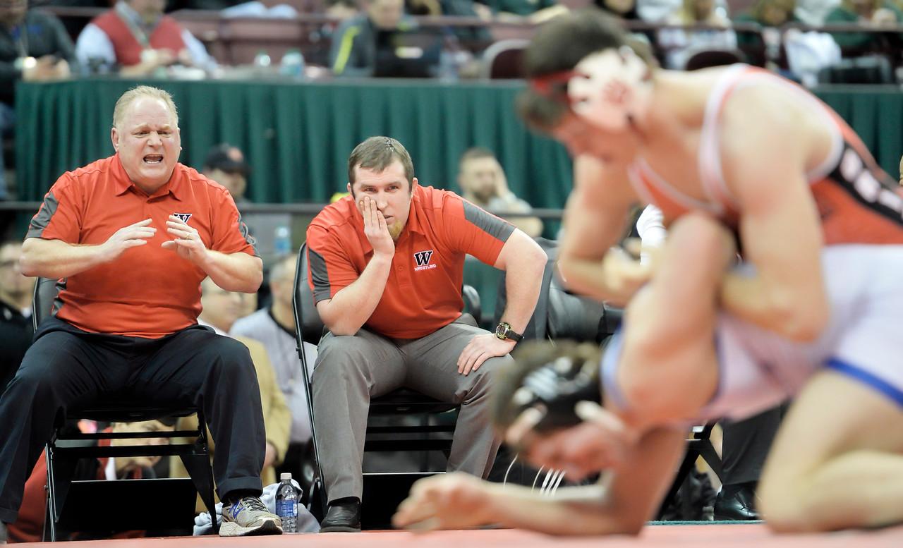 Wadsworth coaches John Gramuglia, left, and Brad Squire watch Joey Baughman during the 160-pound championship match. DAVID RICHARD / GAZETTE