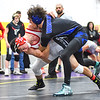 KRISTIN BAUER / CHRONICLE  <br /> Lutheran West High School's Parker Watson wrestles Northwestern High School's Cael Rowland in the 132 lbs weight class on Saturday evening, December 16.