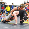 KRISTIN BAUER / CHRONICLE  <br /> North Ridgeville High School's Jared Viancourt wrestles Brookside High School's Jacob Stoehr in the 145 lbs weight class on Saturday evening, December 16.