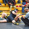 KRISTIN BAUER / CHRONICLE  <br /> Hillsdale High School's Caleb Ritter pins Clearview High School's J.D. McCardle on Saturday afternoon, December 16.