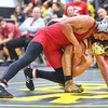 KRISTIN BAUER / CHRONICLE  <br /> Oberlin High School's Robert Bouchonville wrestles Lutheran West High School's Lachlan Thomas in the 126 lbs weight class on Saturday evening, December 16.