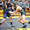 KRISTIN BAUER / CHRONICLE  <br /> Black River High School's Jacob Campbell wrestles Northwestern High School's Colt Slanczka in the 195 lbs weight class on Saturday afternoon, December 16.