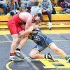 KRISTIN BAUER / CHRONICLE  <br /> Oberlin High School's Riley Horning wrestles Black River High School's Riley Bartolic in the 182 lbs weight class on Saturday, December 16.