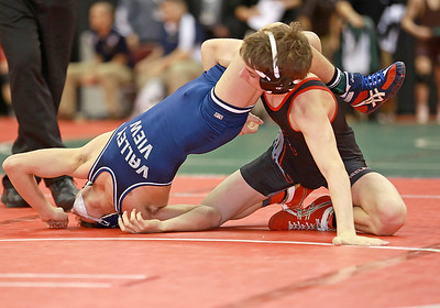 Firelands' Payton Burdorf (right) looks to scored a third period takedown and nearfall points in his 6-4 win over Joey Dima of Valley View. RICK TWINING / CHRONICLE