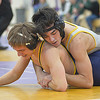 Amherst's Tim Carrion defeats North Ridgeville's Jared Viancourt at 138 pounds in the SWC tournament at Lakewood Feb. 17. STEVE MANHEIM / CHRONICLE
