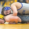 Midview's Andrew Philion, top, defeats Avon Lake's Ethan Shepard on Saturday at 132 pounds in the Southwestern Conference tournament. STEVE MANHEIM /CHRONICLE