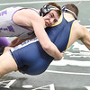 Keystone's David McCullough falls to the mat with Gabe Phillips of Norwalk in a 182-pound match. DAVID RICHARD / CHRONICLE