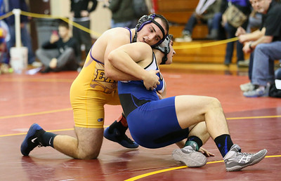 Avon's Joe Travagliante downs Midview's David Croftcheck 11-3 in the 195-pound final Saturday at Avon Lake. RAY RIEDEL/CHRONICLE