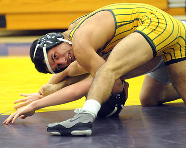 Amherst's Christian Lough defeats Toldeo's Justin Portillo in the 120 weight class. STEVE MANHEIM/CHRONICLE