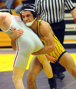Amherst's Christian Lough defeats Toledeo Central Catholic's Justin Portillo. STEVE MANHEIM/CHRONICLE