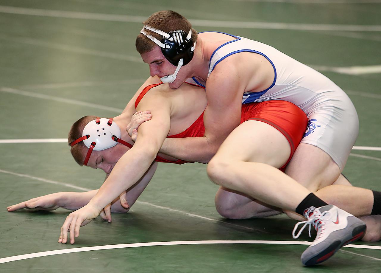 Brunswick's Aaron Naples, top, defeats Oak Harbor's Dylan Thorp 3-2 during the 195-pound semifinals of the MIT. (RON SCHWANE / GAZETTE)