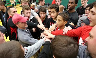 "Elyria Head Coach Erik Burnett tells his Pioneers, ""We not done, yet!"" RICK TWINING/CHRONICLE"