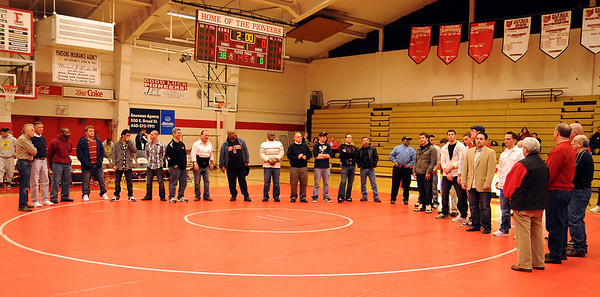 Former Elyria wrestlers were honored in a ceremony for the final match at Elyria High gym Jan. 30.   Steve Manheim