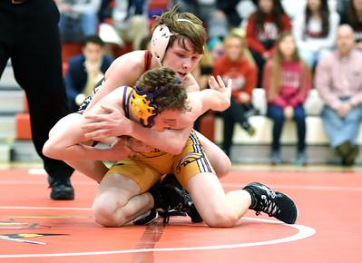 KRISTIN BAUER / CHRONICLE Elyria High School's Matt Zuckerman wrestles Avon High School's Tate Zeman in the 106-lb weight class on Wednesday evening, Feb. 3.  Zuckerman won the match.