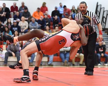 KRISTIN BAUER / CHRONICLE Elyria High School's Ben Darmstadt wrestles Avon High School's Ta'Von Wright in the 195-lb weight class on Wednesday evening, Feb. 3.  Darmstadt won the match.