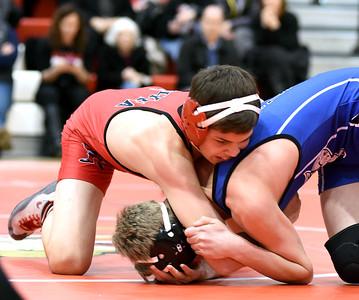 KRISTIN BAUER / CHRONICLE Elyria High School's Josh Breeding wrestles Midview High School's Justin Wendling in the 120 lbs weight class on Wednesday night, Jan. 27.  Breeding won the match.