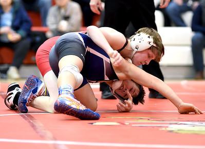 KRISTIN BAUER / CHRONICLE Elyria High School's Matt Zuckerman wrestles Midview High School's Zack Anderson in the 106-lb weight class on Wednesday night, Jan. 27. Zuckerman won the match.