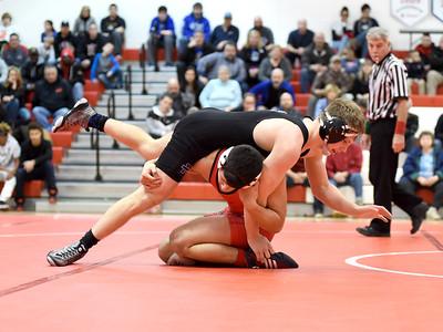 KRISTIN BAUER / CHRONICLE Elyria High School's Nico O'Dor wrestles Midview High School's Trevor Begin in the 152-lb weight class on Wednesday night, Jan. 27. O'Dor won the match.