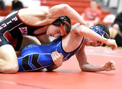 KRISTIN BAUER / CHRONICLE Elyria High School's Jim Schill wrestles Midview High School's Noah Gusky in the 126-lb weight class on Wednesday night, Jan. 27. Schill won the match.