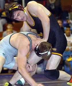 152-pound championship match: Avon Lake's Jimmy Emerson works on Holy Names Jimmy Klosz. Klosz won the match.