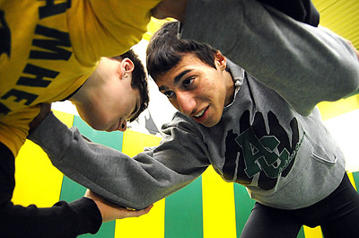 Amherst's Mark Matos, right, with teammate Tyler Harris at practice on Feb. 28.  Matos will compete at state wrestling tournament.   Steve Manheim