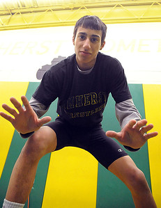 Amherst's Mark Matos will compete at state wrestling tournament, at practice on Feb. 28.  Steve Manheim