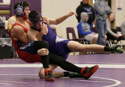 Oberlin's Brendan Ortiz grabs a hold of Vermilion's Justin See at Vermilion High School on Wednesday, Dec. 30, 2015. BRIAN J. SMITH/CHRONICLE