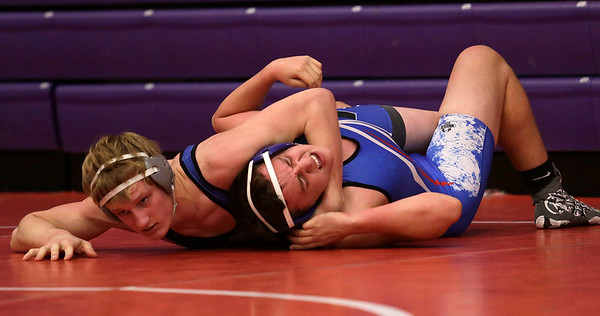 Midview's Seth Frambuch (left) pins his opponent from Bay Village at Vermilion High School on Wednesday, Dec. 30, 2015. BRIAN J. SMITH/CHRONICLE
