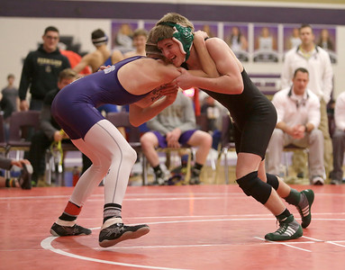 Columbia's Justin Clark faces off against Vermilion's Josh Flynn at Vermilion High School on Wednesday, Dec. 30, 2015. BRIAN J. SMITH/CHRONICLE