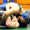 Midview Isaac Payne pins EC Jarrod Shill in 145 wt. class at Elyria Catholic Dec. 14.  Steve Manheim