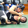Midview Mike Plas, rear, defeats EC Tyler Filiaggi in 152 wt. class at Elyria Catholic on Dec. 14.   Steve Manheim