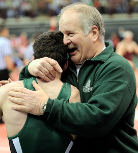 Westlake coach Mike Antonyzyn congratulates Nick Lawrence after his win in a Div. I, 125-pound match yesterday in Columbus. DAVID RICHARD / CHRONICLE