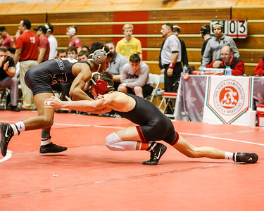 Elyria's Mick Burnett with the shot against Massillon Perry at the Ohio State Dual Wrestling tournament Feb. 12. JOE COLON / CHRONICLE