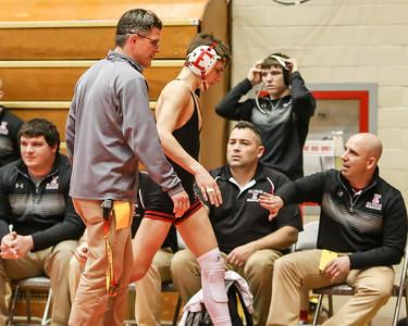 Coach Burnett (left) congratulates his son Mick Burnett following his victory over Massillon Perry at the Ohio State dual wrestling tournament Feb. 12. JOE COLON / CHRONICLE