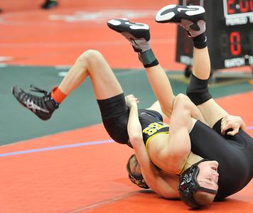 Black River's Sebastian Vidika, front, rolls over Jake Adkins of Johnstown Northridge in the state semifinal match. DAVID RICHARD