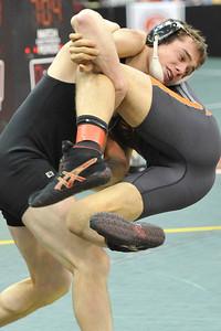 Elyria Catholic's Jerot Schill, left, takes down Van Buren's Chance Sonnenberg in a 160-pound match. DAVID RICHARD / CHRONICLE